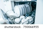 Open dishwasher with clean dishes, close up - stock photo