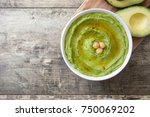 avocado hummus in bowl on... | Shutterstock . vector #750069202