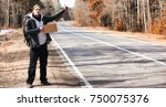 a young man is hitchhiking... | Shutterstock . vector #750075376