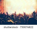 cheering crowd with hands in... | Shutterstock . vector #750076822