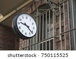 clock and retro wall | Shutterstock . vector #750115525