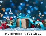 gift or present box  snowy fir... | Shutterstock . vector #750162622