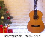 guitar christmas with holiday... | Shutterstock . vector #750167716