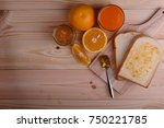 bread set with orange jam and... | Shutterstock . vector #750221785