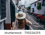 woman with a white hat and a... | Shutterstock . vector #750226255