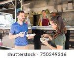 good looking friends talking... | Shutterstock . vector #750249316