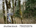Small photo of Pump Chance: Pump chance signage attached to trees in the woods near a clear-cut.