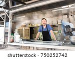 good looking young man standing ... | Shutterstock . vector #750252742
