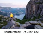 misty morning on preikestolen ... | Shutterstock . vector #750254122