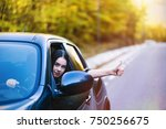 a beautiful brunette driver... | Shutterstock . vector #750256675