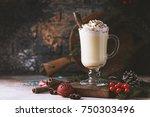 traditional winter eggnog in... | Shutterstock . vector #750303496