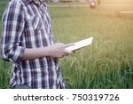agriculture using tablet... | Shutterstock . vector #750319726