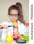 Small photo of Little scientist girl, Chemistry class
