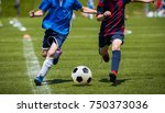 children kicking soccer match... | Shutterstock . vector #750373036