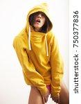 sexy woman in yellow hoodie...   Shutterstock . vector #750377836