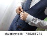 the groom wears cufflinks for... | Shutterstock . vector #750385276