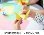 human hands folding sheet of... | Shutterstock . vector #750420706