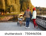 young loving family walks by... | Shutterstock . vector #750446506