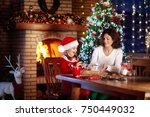 mother and daughter baking... | Shutterstock . vector #750449032