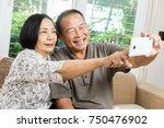 happy senior asian couple... | Shutterstock . vector #750476902