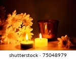 three candles and flowers on...   Shutterstock . vector #75048979