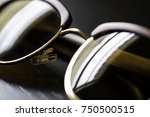 wooden sunglasses on a black... | Shutterstock . vector #750500515