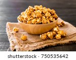 popcorn with caramel in bowl | Shutterstock . vector #750535642