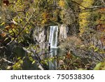 A Large Waterfall Flows Over A...