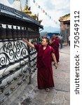 buddhist monk spinning prayer... | Shutterstock . vector #750549112