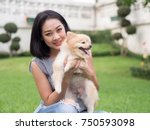 asian woman plays with her... | Shutterstock . vector #750593098