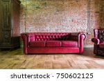 Red Sofa Against A Brick Wall...