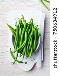 green beans in white bowl on... | Shutterstock . vector #750634912