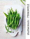 green beans in white bowl on... | Shutterstock . vector #750634912