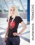 Small photo of Tolyatti, Russia - May 13-14, 2017. Cosplayer posing at the Animation Zone, dedicated to video games, TV series and comics, anime, manga, cosplay. Modern Daenerys, Game of Thrones.