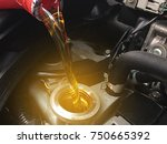 close up oil for car engine. | Shutterstock . vector #750665392