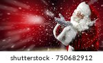 santa claus blows snow from his ... | Shutterstock . vector #750682912