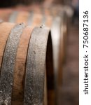Small photo of Wooden wine barrels in cellar in cellar