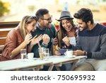 group of four friends having... | Shutterstock . vector #750695932