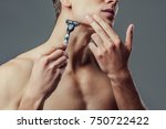 cropped image of handsome young ...   Shutterstock . vector #750722422