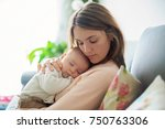 young mother  holding tenderly... | Shutterstock . vector #750763306