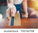close up woman hand holds a... | Shutterstock . vector #750763708