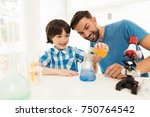 father and son conduct chemical ... | Shutterstock . vector #750764542