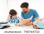 father helps his son to do... | Shutterstock . vector #750764722