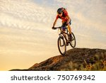 cyclist in red t shirt riding... | Shutterstock . vector #750769342