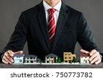 businessman selling houses | Shutterstock . vector #750773782