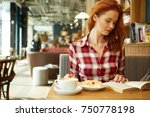 girl in a cafe | Shutterstock . vector #750778198