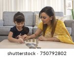 mother and daughter stacking... | Shutterstock . vector #750792802