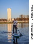 Small photo of MINSK, BELARUS - MAY 06,2017 - People is riding on SUP boards on water in city