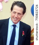 Small photo of LONDON - NOV 05, 2017: Hugh Grant attends the Paddington 2 film premiere in London