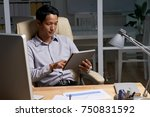 young entrepreneur using... | Shutterstock . vector #750831592